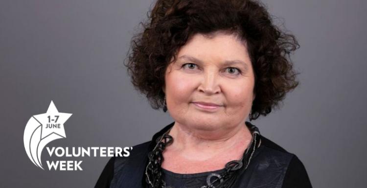 woman smiling at camera with Volunteers Week logo in corner