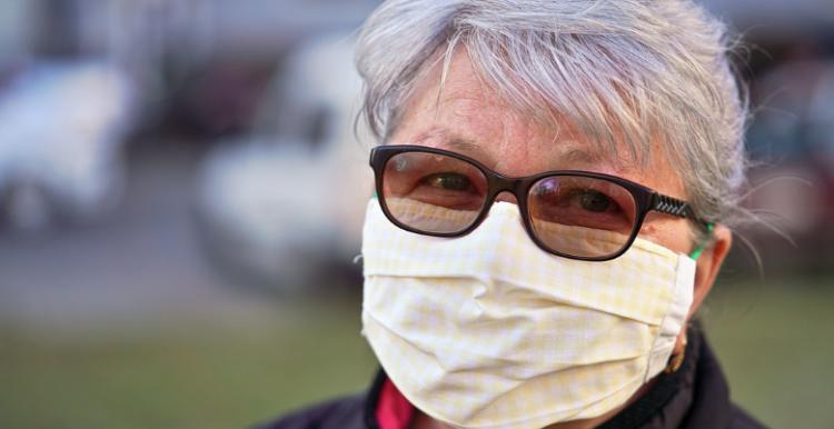 woman wearing a mask looking at camera
