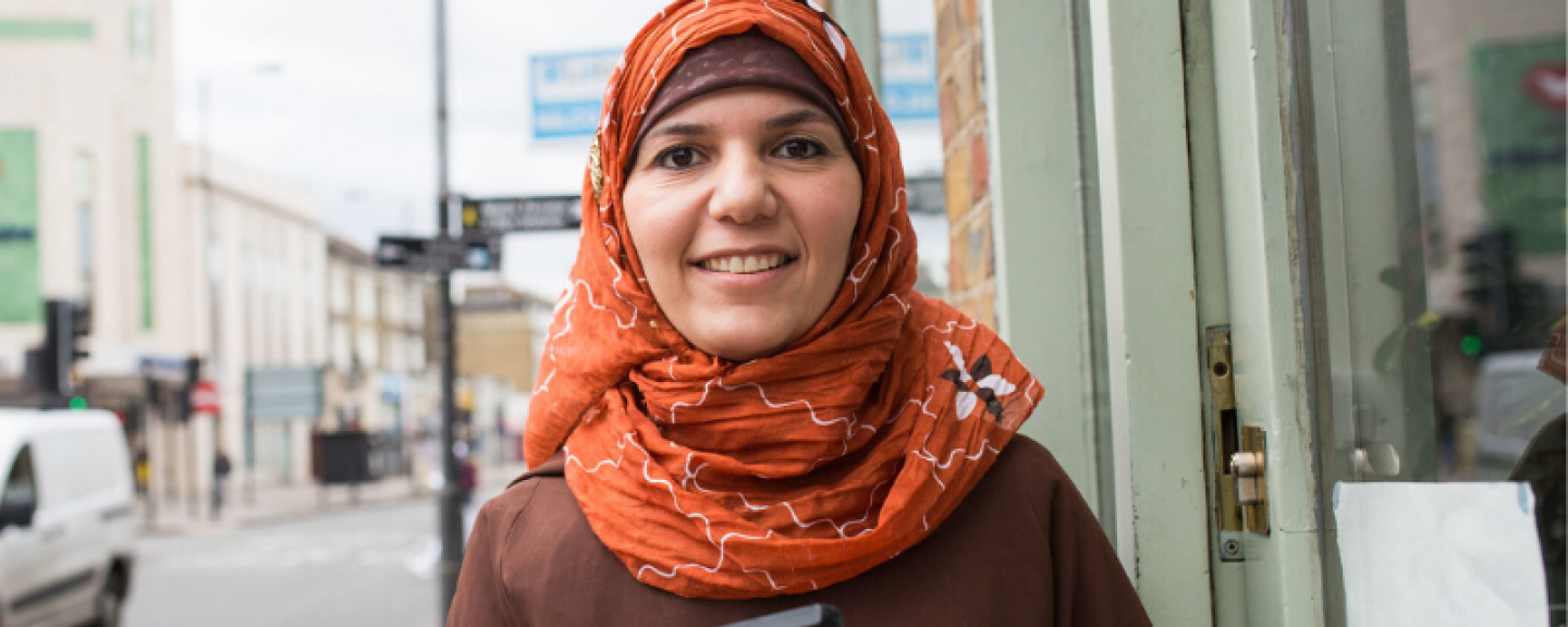 lady in headscarf smiling at camera