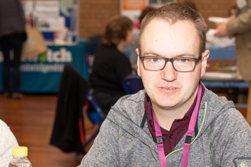 Picture shows man at Healthwatch event looking at the camera