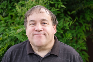 man smiling into camera