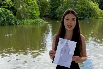 young woman holding her dissertation
