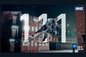 photo showing man falling off his bike
