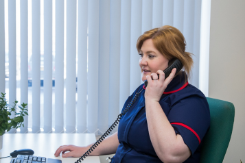 Nurse talking on the phone to patient