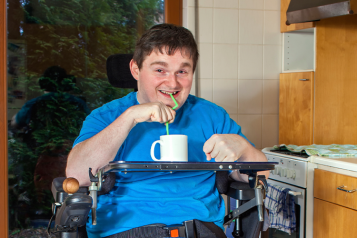 Picture shows disabled man in his kitchen