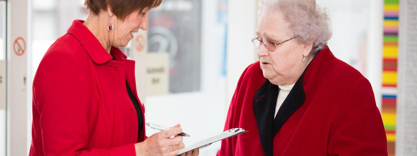 Picture shows Healthwatch volunteer talking to a patient