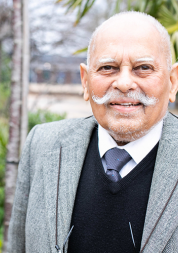Picture shows older man of South Asian origin looking at the camera