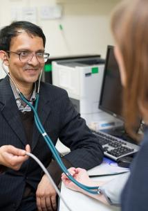 Picture shows a GP taking the bloodpressure of a female patient