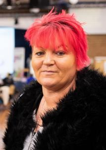 lady with red hair looking at camera